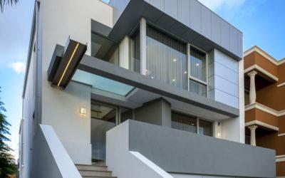 Modern Front Facade of three storey 4 bedroom 3 bathroom luxury narrow lot home by custom home builder prima homes