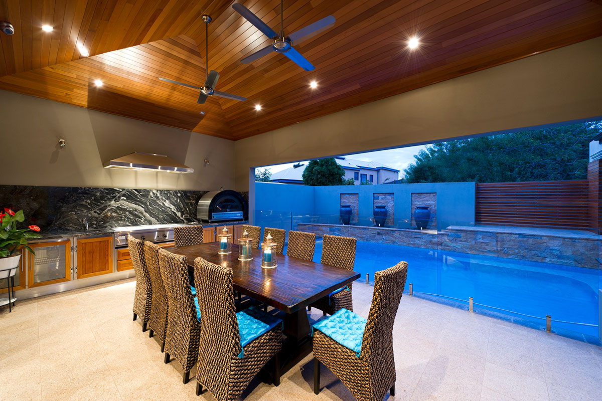 Outdoor Dining Area with luxury fitout overlooking pool in south perth custom home by prima homes.