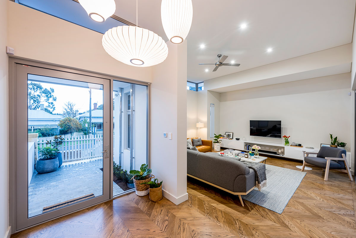 Entrance hall and view to lounge room with parqutry wooden floor in this claremont 8m narrow lot 2 storey home