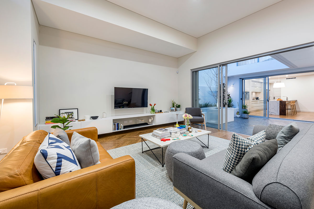 Stunning light and airey Private Lounge room with centre courtyard looking through large framed windows to Kitchen and dining areas Claremont Perth