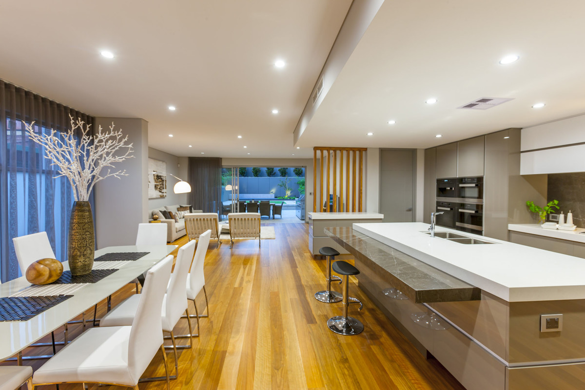 oppulant light bright and airy kitchen and dining area with hardwood floors custome design and construct home by prima homes