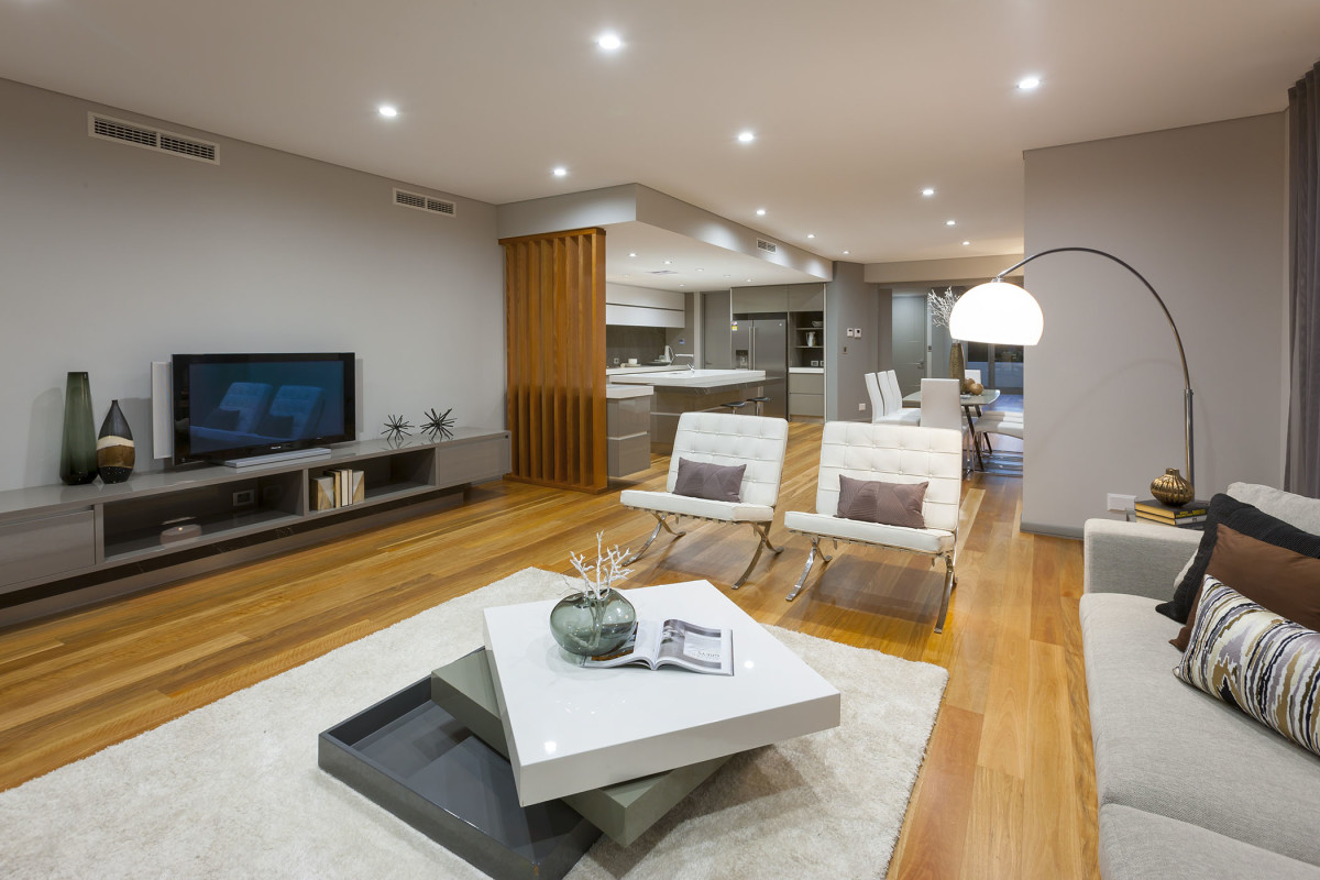 Photo of the expansive lounge room with views through to seperate dining and kitchen areasshowing off the amount of space this luxury custom built 10m narrow block home affords