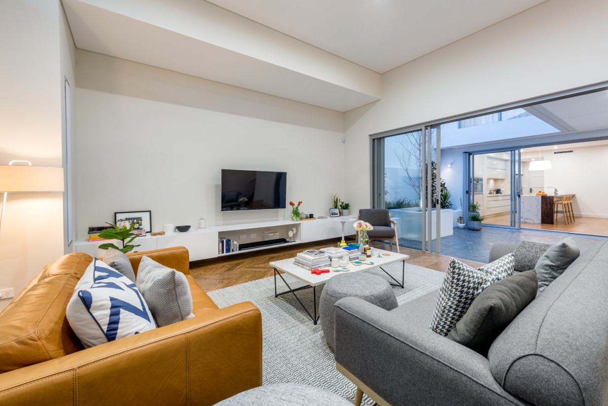 The Stretto 2 storey display home claremont view of loungeroom overlooking courtyard