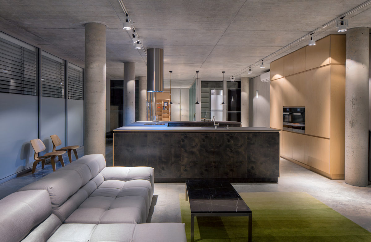 North Beach off form concrete home lounge and kitchen by Prima Designer Homes