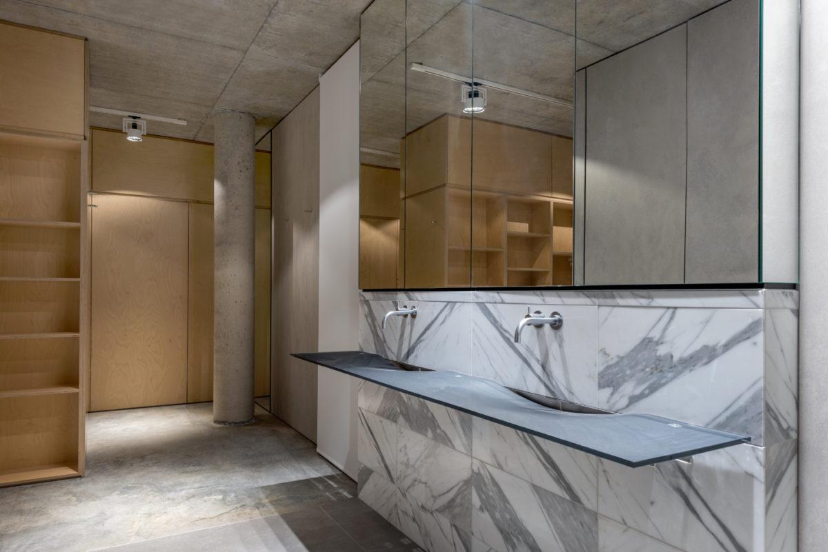 North Beach off form concrete home master bathroom by Prima Designer Homes