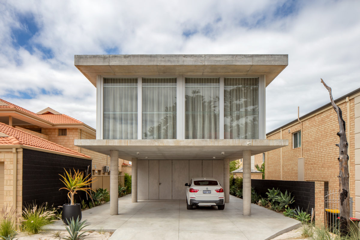 Exterior industrial style concrete home custom architect designed in industrial style built by Prima Homes