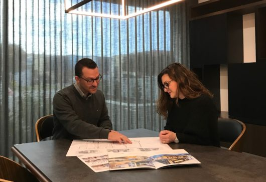 Prima Homes Ryan Secola with client reviewing building project